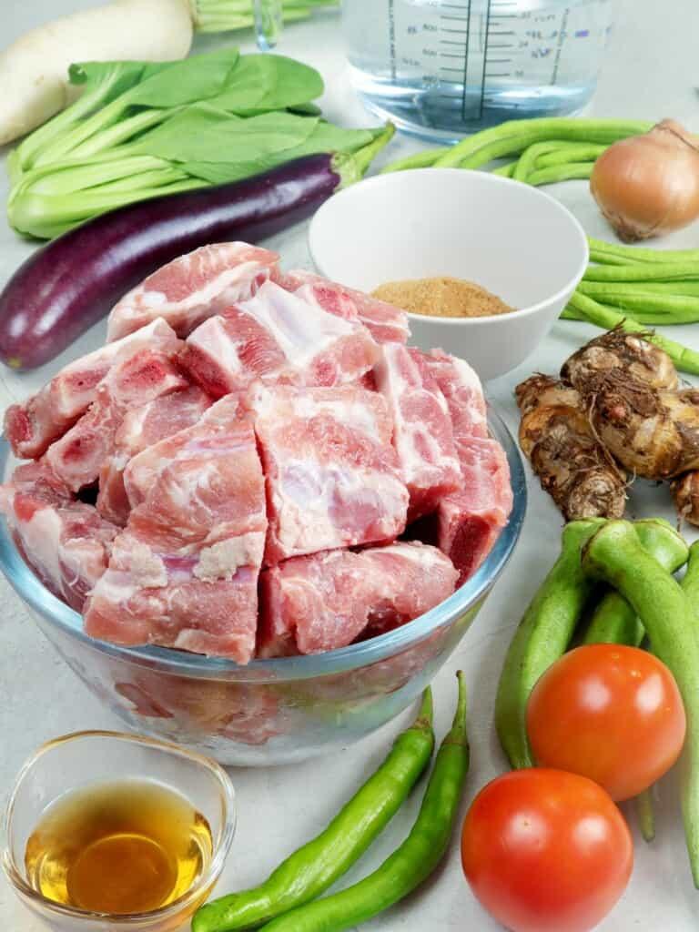 pork spare ribs, egg plant, radish, gabi, tomatoes, chili pepper, fish sauce, tamarind powder, pechay, sitaw