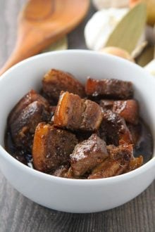 adobong baboy in a white bowl