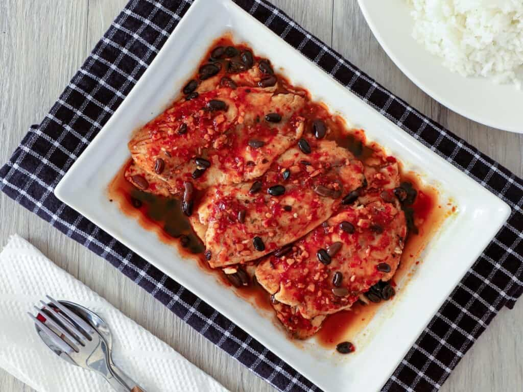 Tilapia with Black Bean Garlic Sauce on a white serving platter