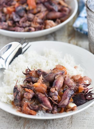 ginisang pusit with steamed rice on a white plate