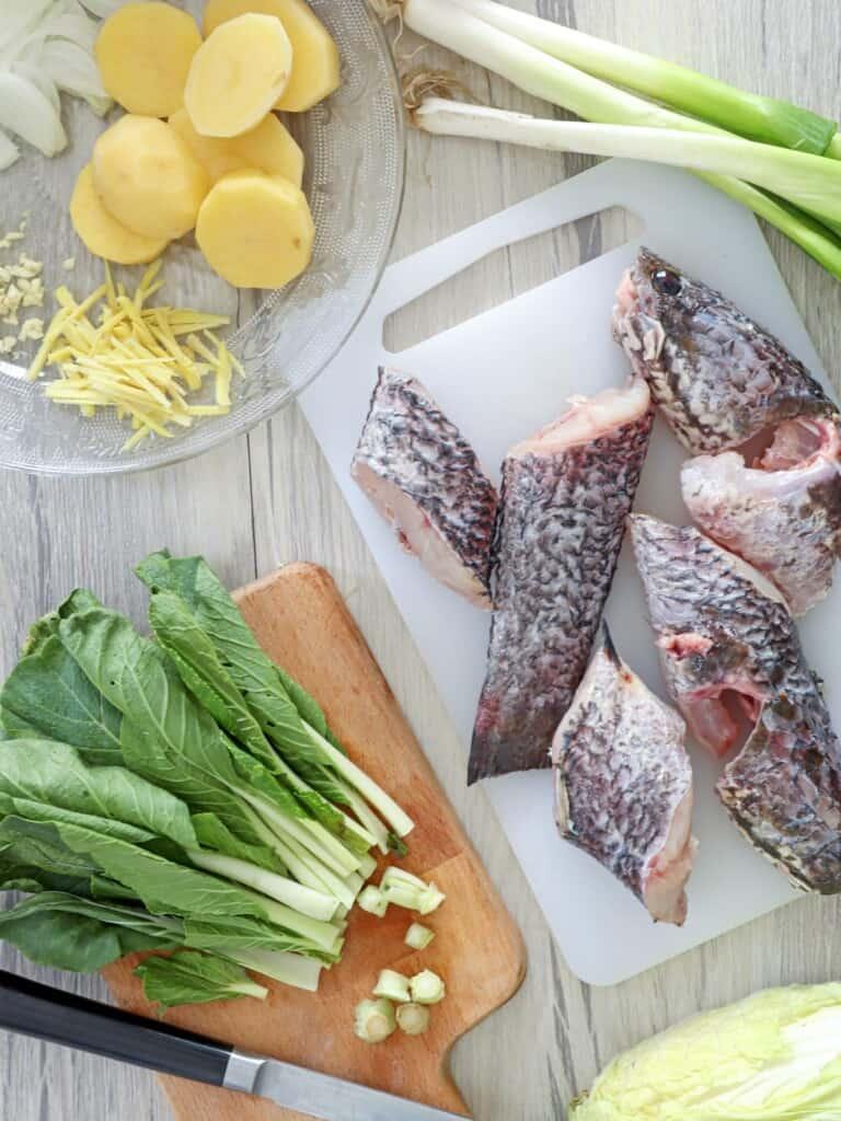 raw mudfish and vegetables to make pesang isda