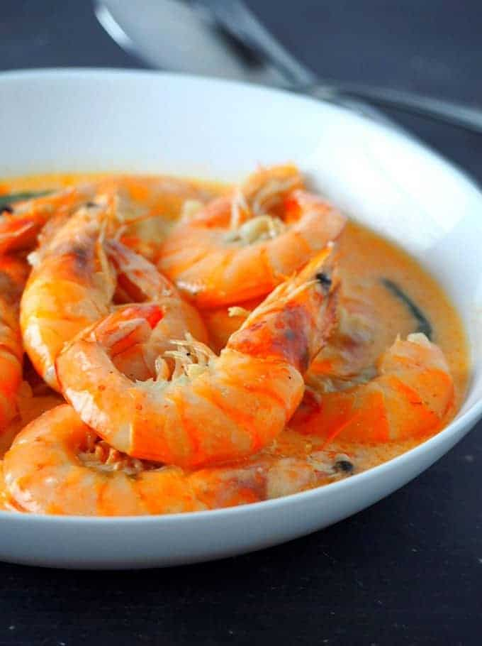 shrimp in creamy coconut milk in white serving bowl