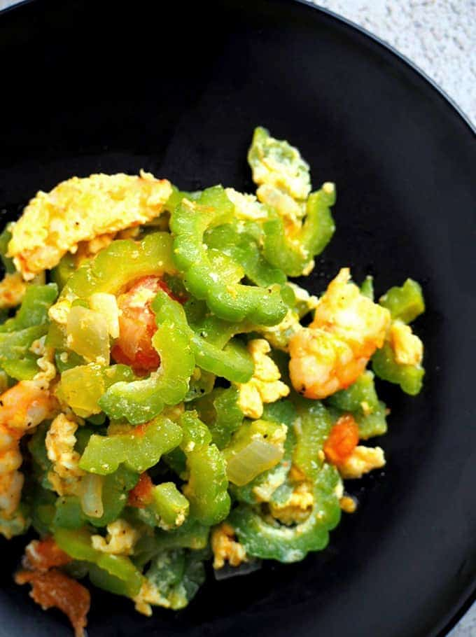 ampalaya stir-fry on a black serving plate