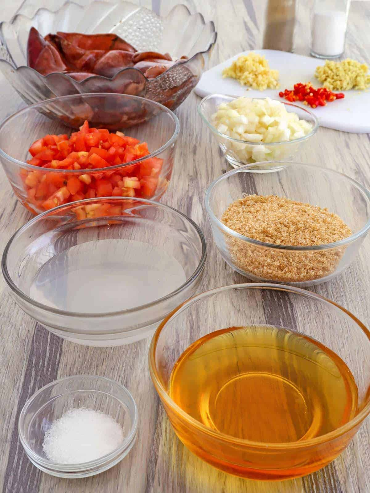 jumbo squid, honey, viengar, brown sugar, minced garlic, chopped chili peppers in bowls