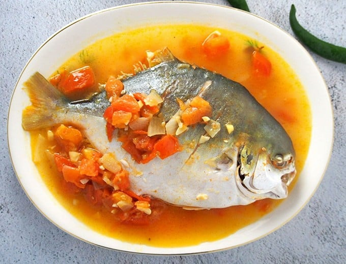 Pinangat na Pompano on a white platter