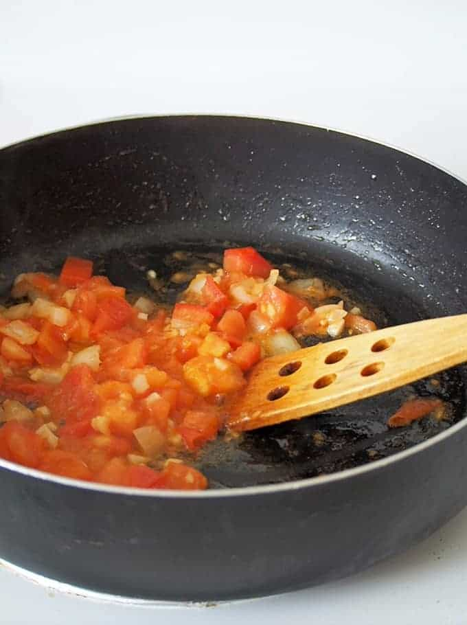 tomatoes, onions, and garlic sauteed in a pan