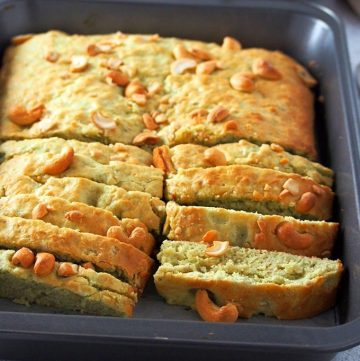 Banana Bread with Pandan and Cashews in a baking pan