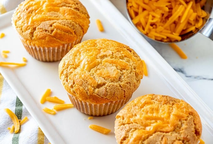 cheese cupcakes on a white platter
