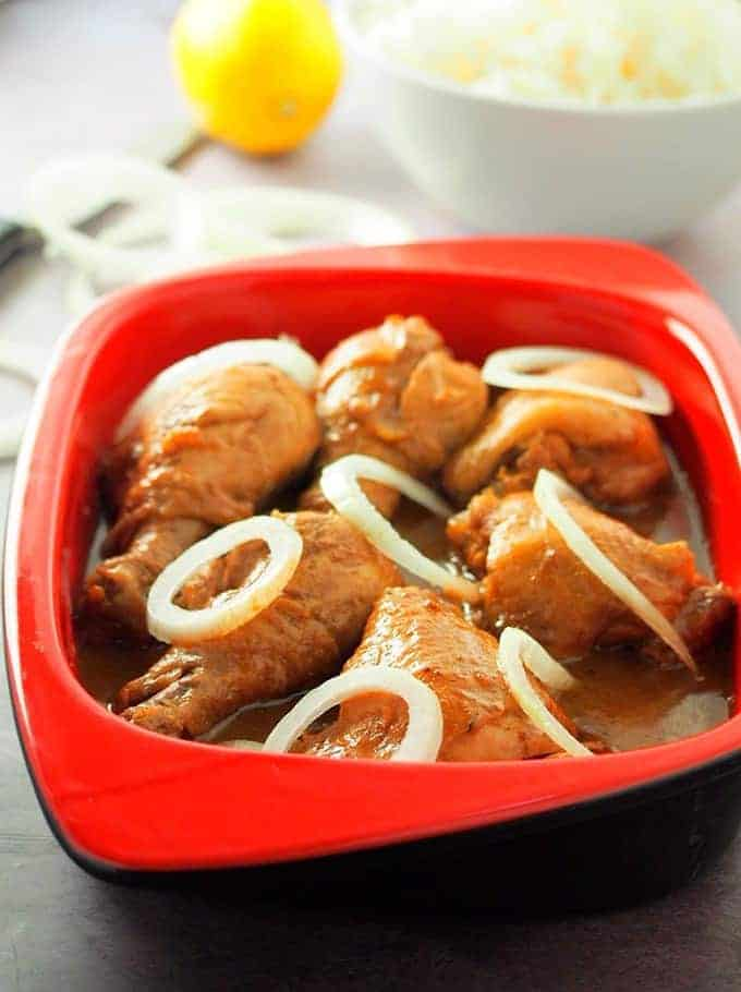 Chicken Bistek in a red serving dish