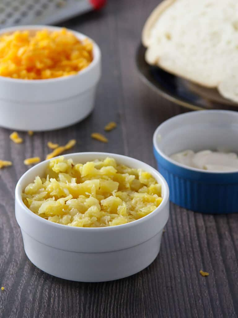 crushed pineapple, mayonnaise, shredded cheese in small bowls