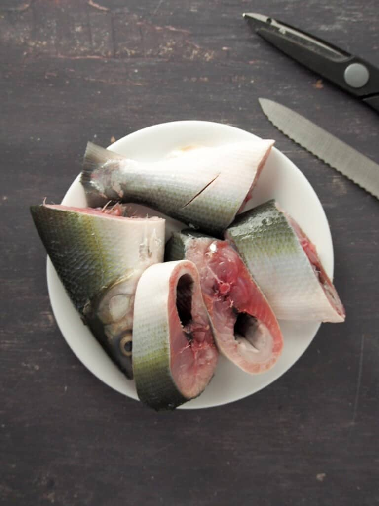 sliced milkfish on a white plate