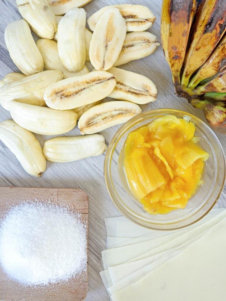 peeled and sliced saba bananas, sweetened jackfruit, sugar, lumpia wrappers