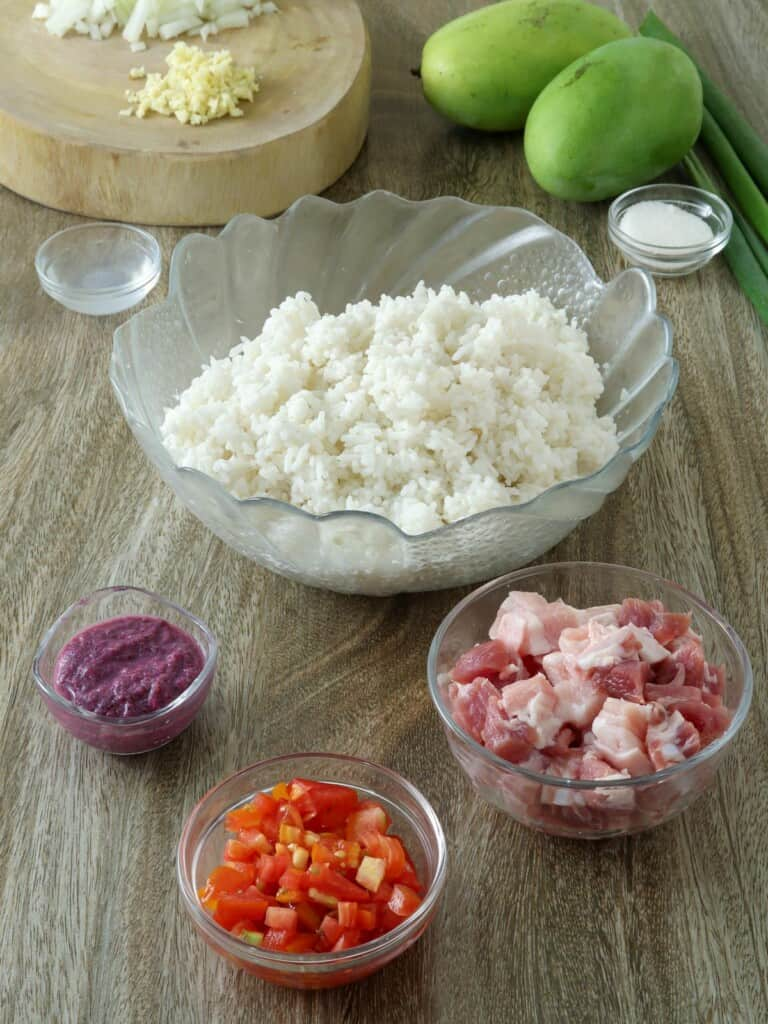 steamed rice, shrimp paste, chopped tomatoes, pork belly, onion, garlic, green mangoes