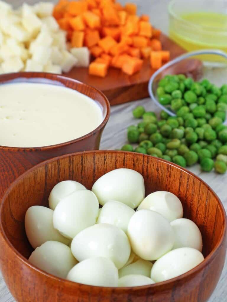 peeled hardboiled quail eggs, green peas, diced carrots, diced singkamas, heavy cream