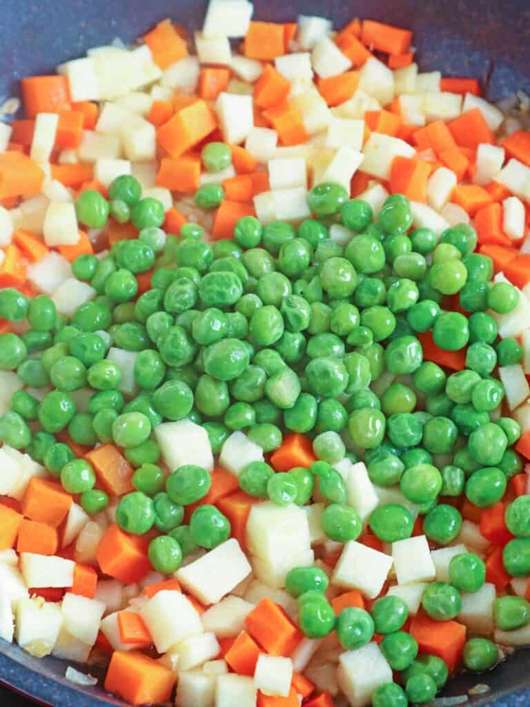 making sipo eggs with carrots, green peas, singkamas