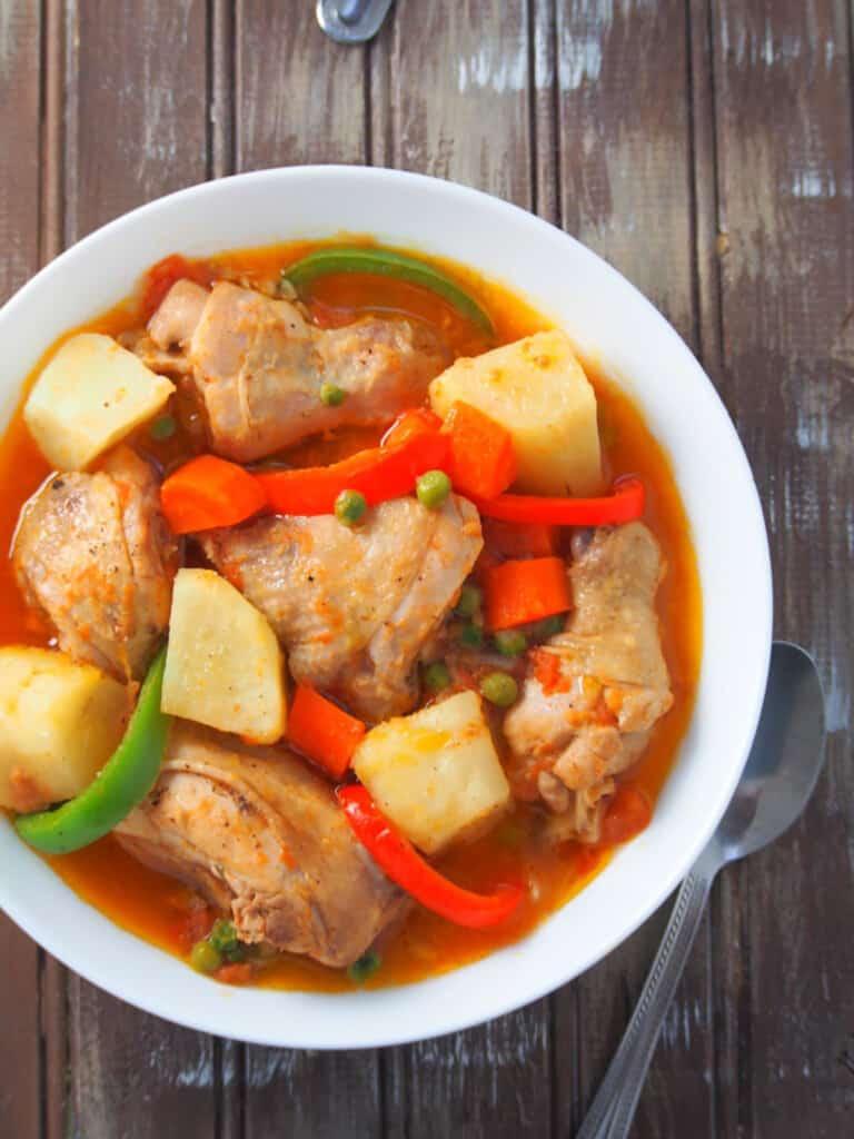 afritadang manok with pinya in a serving dish