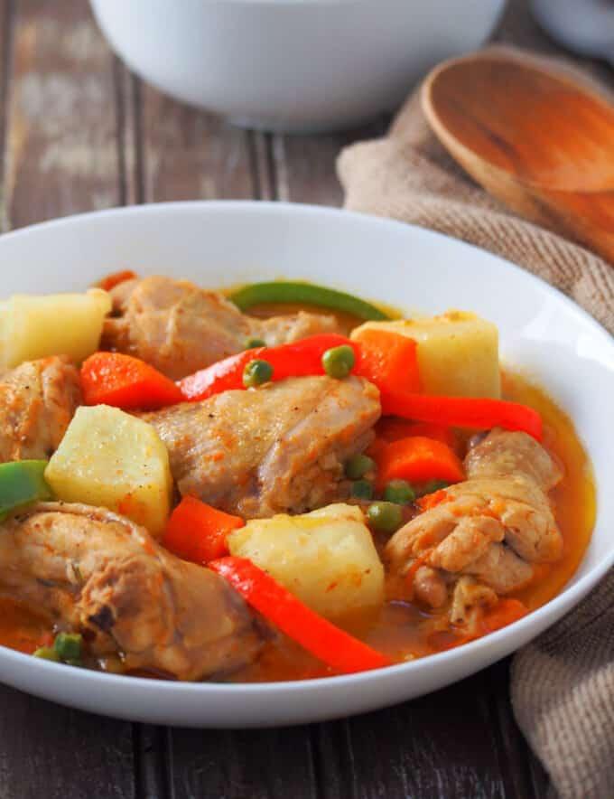 Chicken Afritada in a white serving platter