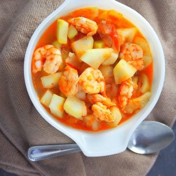 ginisang upo with shrimp in a white bowl