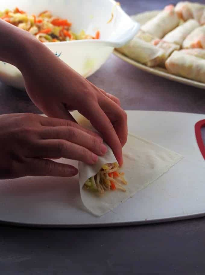 "rolling lumpiang prito ""width ="" 680 ""height ="" 910 ""data pin description ="" Lumpiang Prito packed with tofu, bean sprouts and vegetables. Crunchy and tasty, these Filipino style spring rolls are a great snack or appetizer. ""Data-pin-title ="" Lumpiang Prito ""srcset ="" https://www.kawalingpinoy.com/wp-content/uploads/2013/10/lumpiang-prito-3.jpg 680w, https://www.kawalingpinoy .com / wp-content / uploads / 2013/10 / lumpiang-prito-3-673x900.jpg 673w ""sizes ="" (max width: 680px) 100vw, 680 px"
