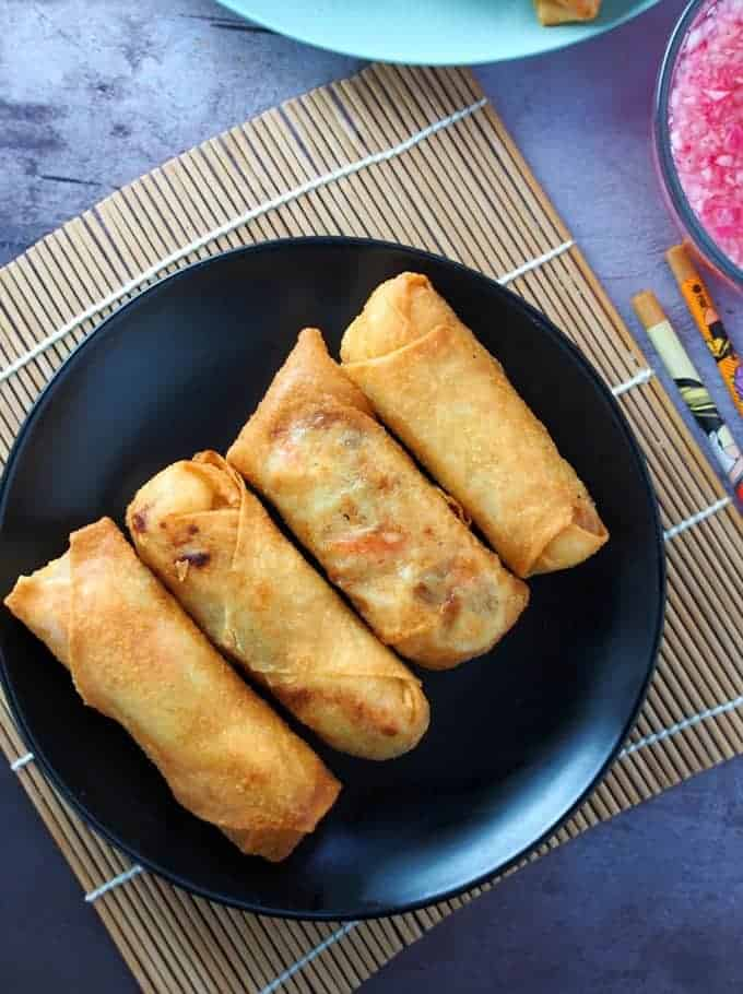 "viewed from above by lumpiang gulay on a black plate ""width ="" 680 ""height ="" 910 ""data-pin-description ="" Lumpiang Prito filled with tofu, bean sprouts and vegetables. Crunchy and tasty, these Filipino style spring rolls are a great snack or appetizer. ""Data-pin-title ="" Lumpiang Prito ""srcset ="" https://www.kawalingpinoy.com/wp-content/uploads/2013/10/lumpiang-prito-4.jpg 680w, https://www.kawalingpinoy .com / wp-content / uploads / 2013/10 / lumpiang-prito-4-673x900.jpg 673w ""sizes ="" (max-width: 680px) 100vw, 680 px"