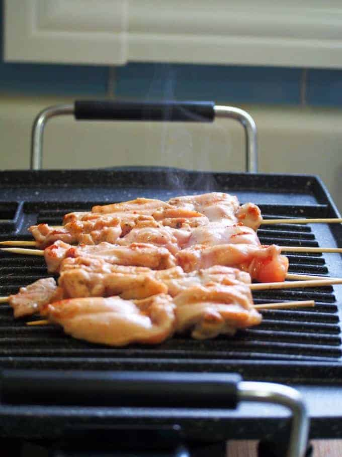grilling mango chicken bbq skewers on an indoor grill