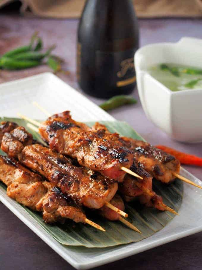 Sweet Mango Barbecue Chicken Skewers on a white serving platter