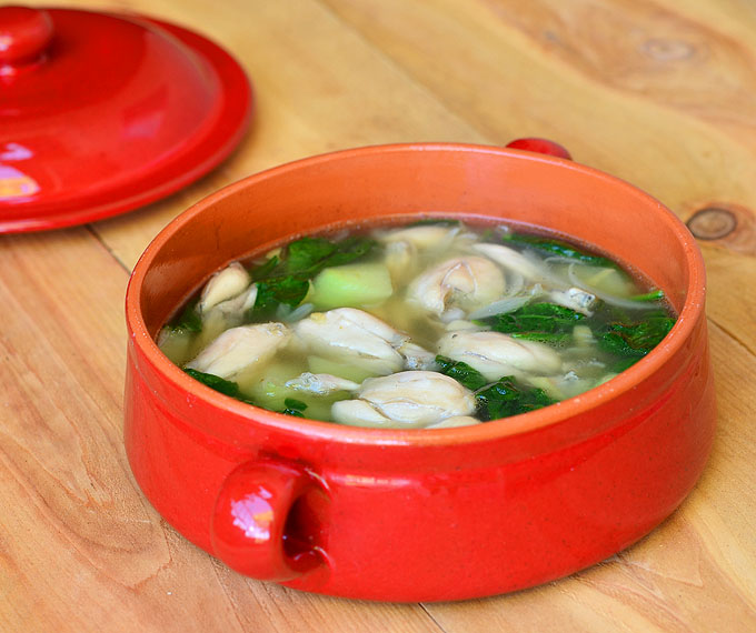 This authentic frog leg soup is served hot in a ceramic bowl.