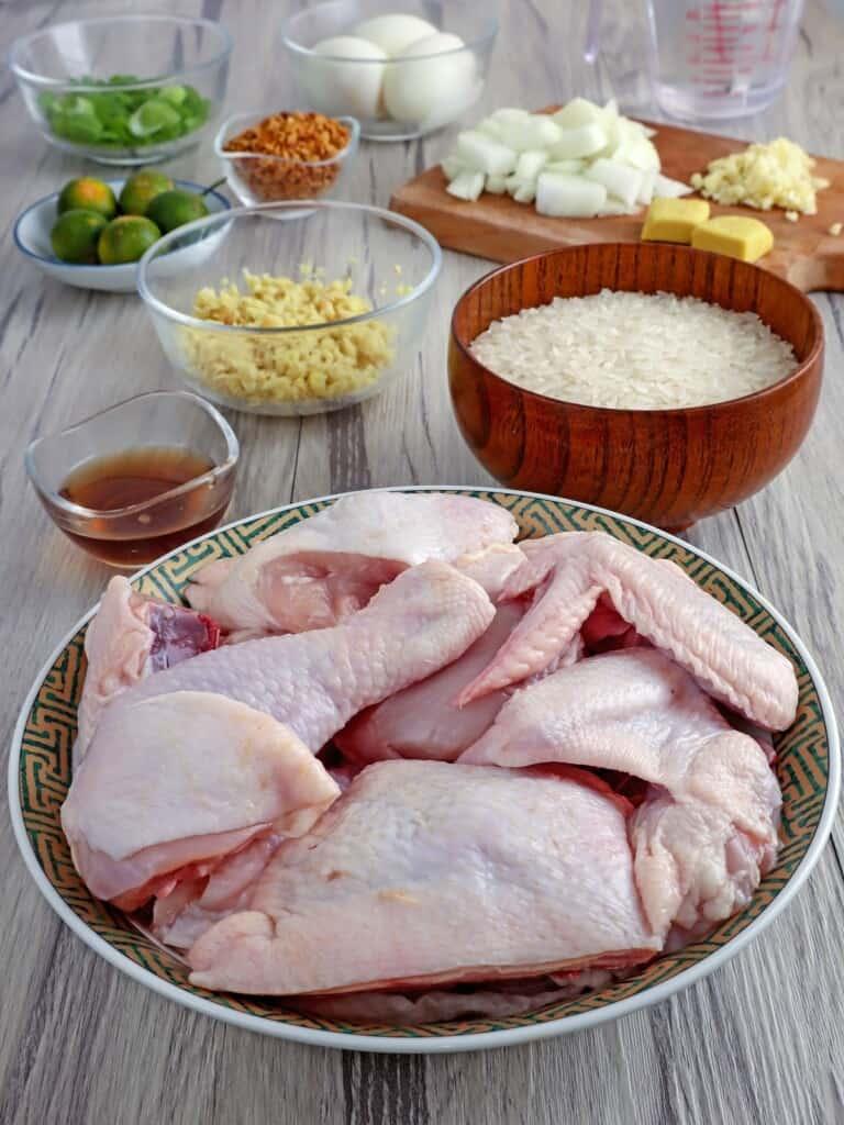 chicken cut-up, rice, ginger, fish sauce, calamansi, fried garlic bits, chopped onions, minced garlic