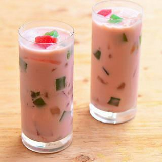 Buko salad drink made with young coconut, gelatin, sago, and palm fruits. Sweet and creamy, it's the perfect summer refreshment!