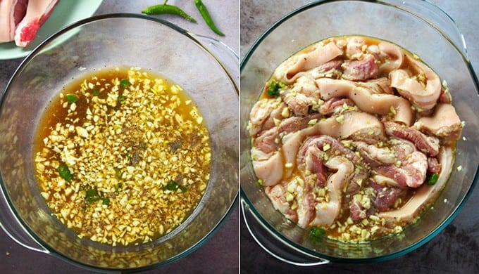 pork belly marinating in calamansi mixture in a large glass bowl
