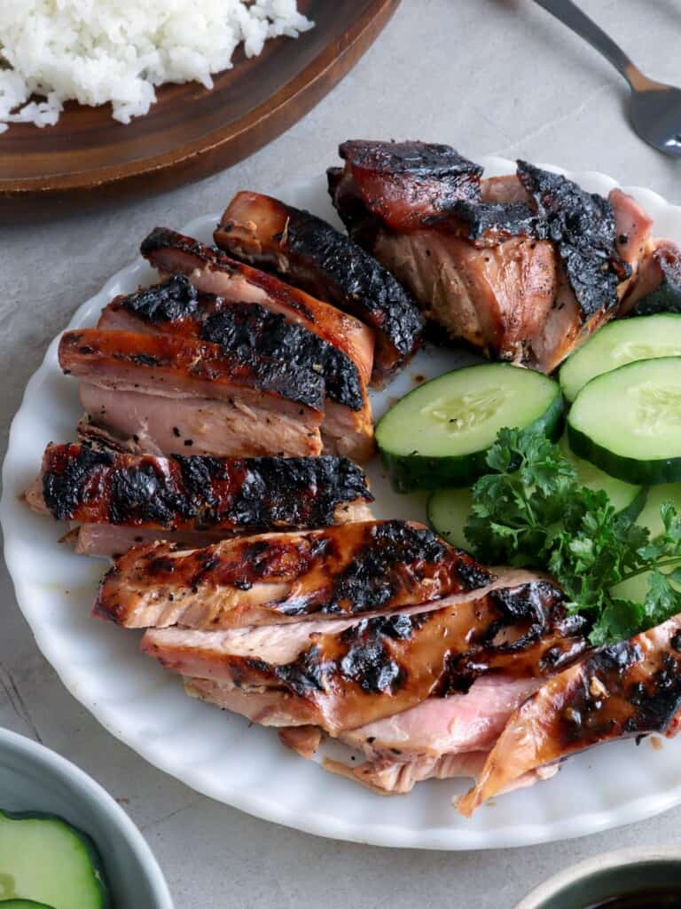 sliced Grilled Tuna Belly on a white plate