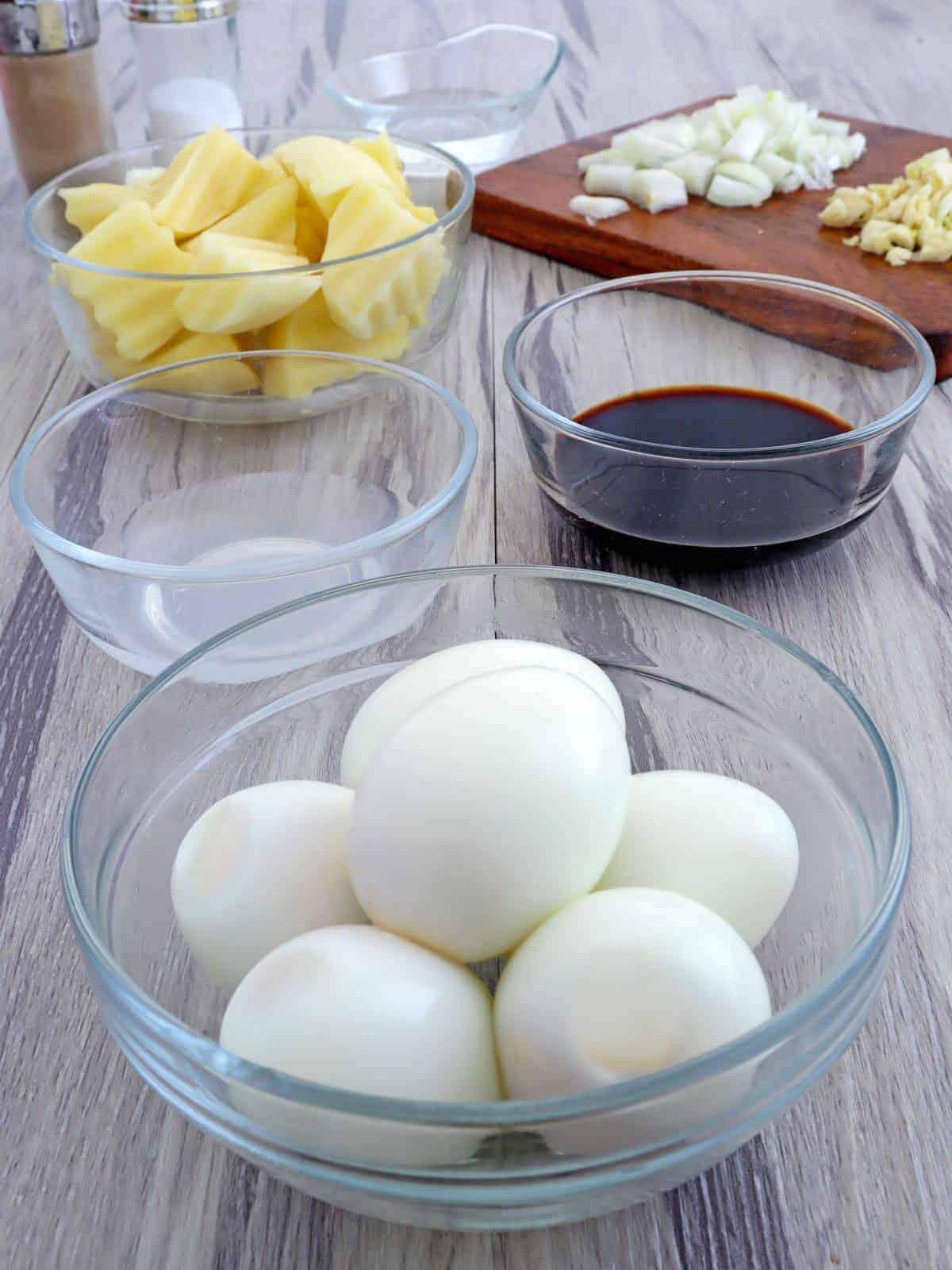 peeled hard-boiled eggs, soy sauce, cubed potatoes, vinegar, chopped onions, minced garlic