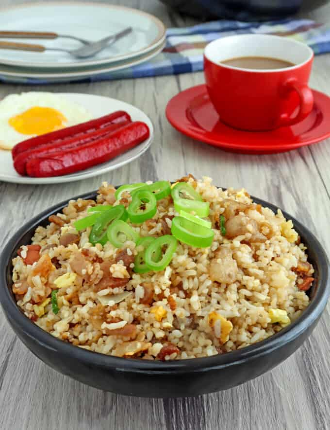 Bacon Fried Rice in a bowl with a side of fried egg and hotdogs