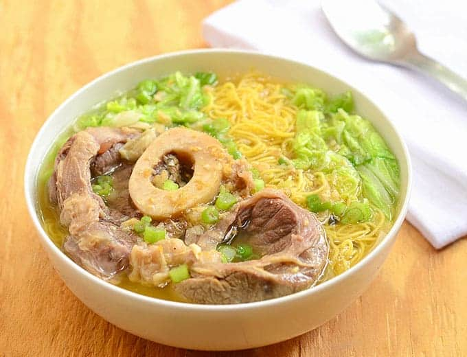 This Filipino noodle soup with steak and lots of herbs is tasty.