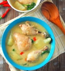 top view of chicken halang halang in a blue serving bowl