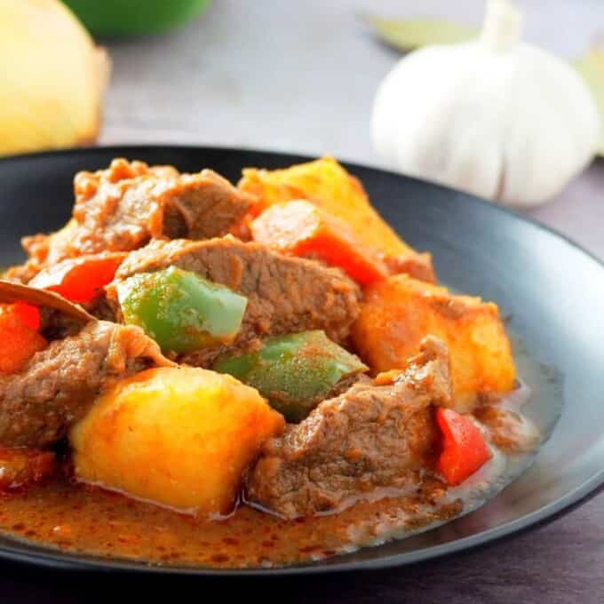 Beef Mechado on a black plate