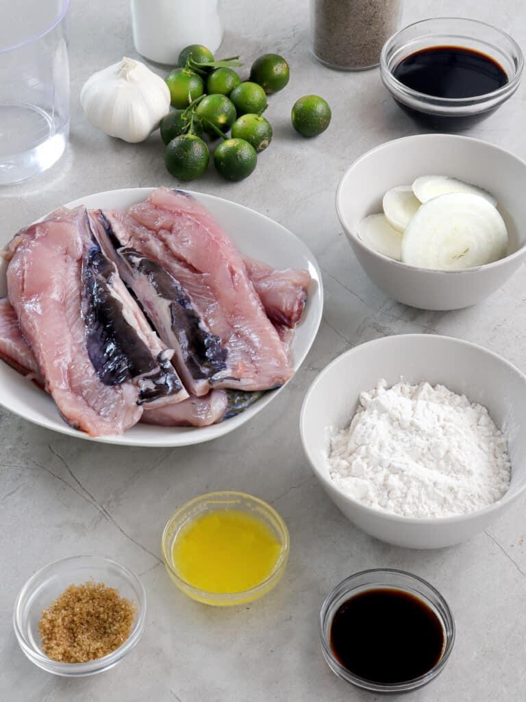 bangus fillets, flour, onion rings, calamansi, soy sauce, fried garlic