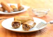 These pork filled spring rolls are fried perfectly and golden brown.