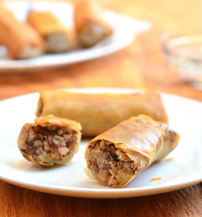 These spring rolls are filled with a delicious meat mixture and fried to perfection.