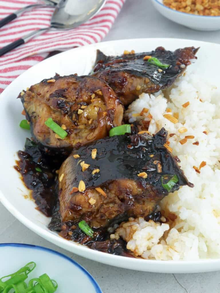 catfish adobo on a serving plate with steamed rice