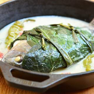 Sinanglay na Tilapia stuffed with onions and tomatoes, wrapped in pechay leaves, and cooked in coconut milk is a Bicolano dish everyone will love. It's moist, flavorful and best served with steamed rice.