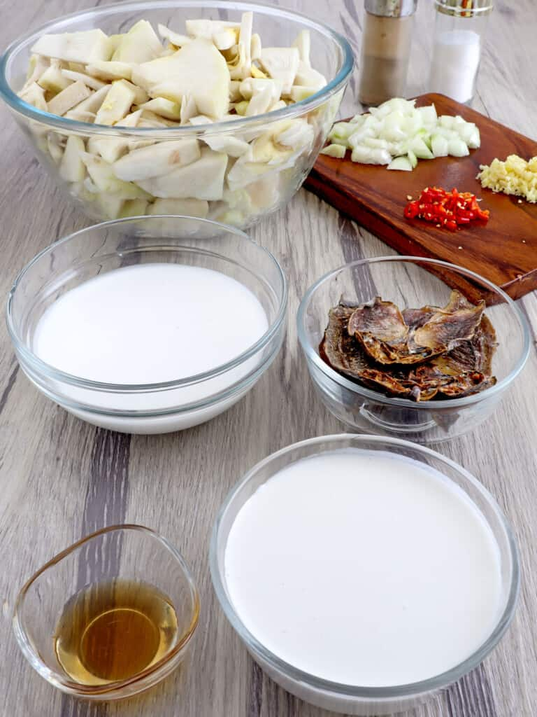 sliced green jackfruit, coconut milk, fish sauce, onions, garlic, chili peppers, dried fish