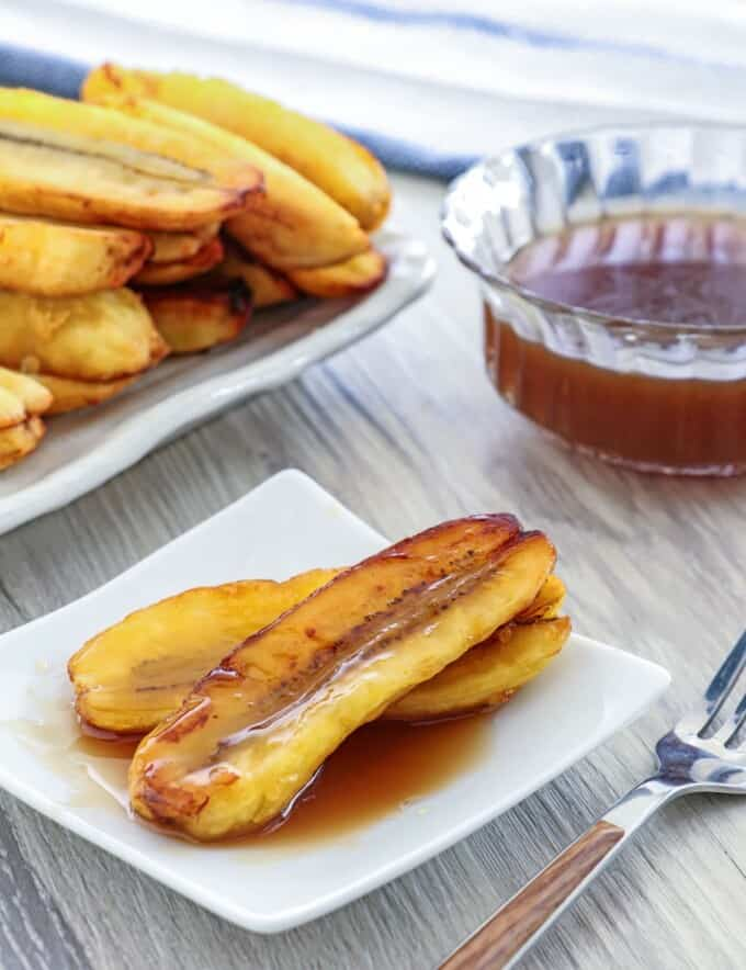 Fried Bananas with Salted Coconut Caramel Sauce on a white serving plate