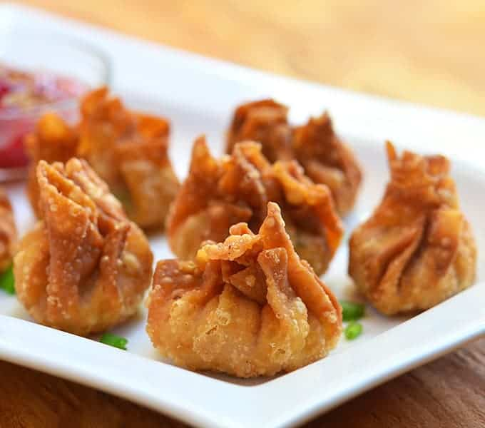 These wontons are crispy and served with a dipping sauce.