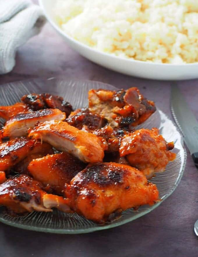cut up Chicken Tocino on a clear glass serving platter