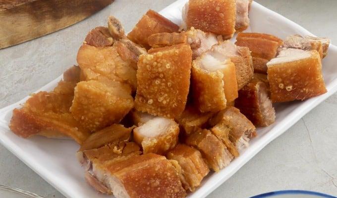 chopped lechon kawali on a serving platter