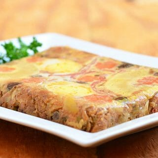 Hardinera made with a colorful diced pork mixture topped with eggs and pineapple and steamed to perfection in molds. This Filipino-style meatloaf is as pretty as it is delicious!