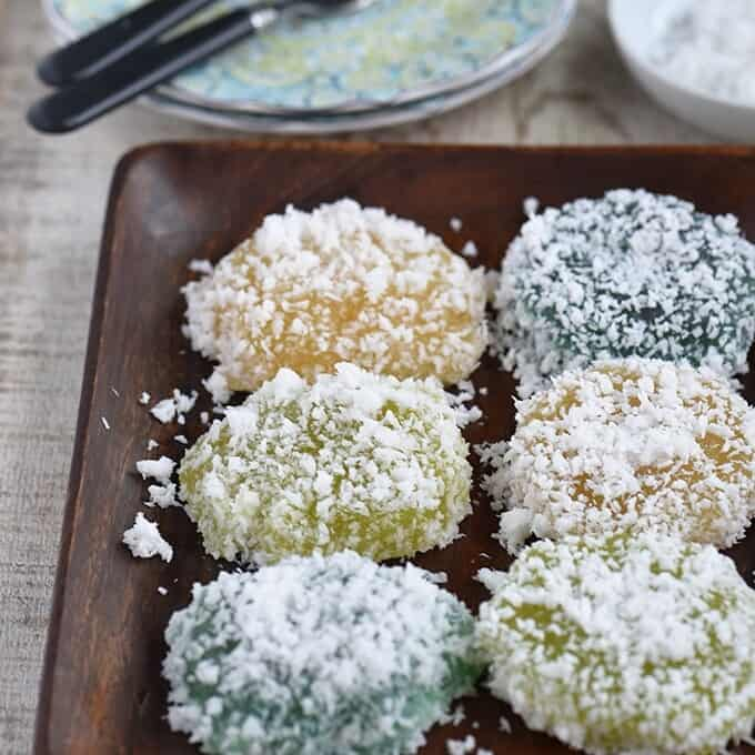 pichi-pichi with different flavors and coated with grated coconut on a wooden serving platter