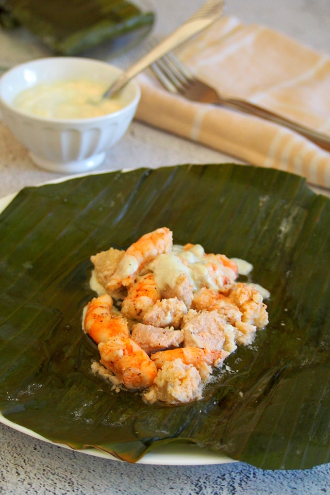 Pinais na Hipon on a serving plate with a bowl of coconut sauce on the side
