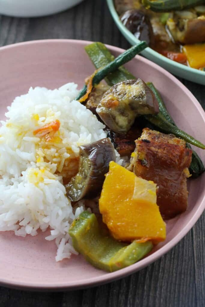 vegetable stew with crispy pork with steamed rice on a plate